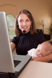 Working Mother Holding Sleeping Baby